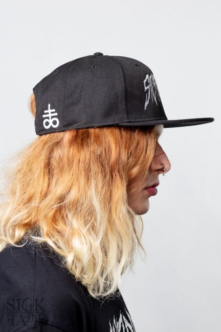 Side view of the SickFace black snapback and leviathan cross embroidery on the back side.
