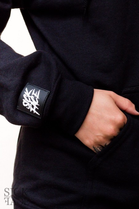 Detail on sleeve branded with SickFace rubber tag logo brand.