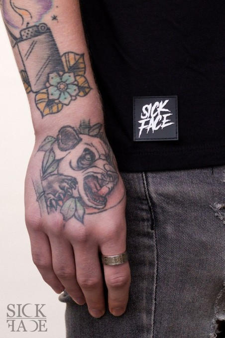 Detail of the Sickface rubber tag brand logo.