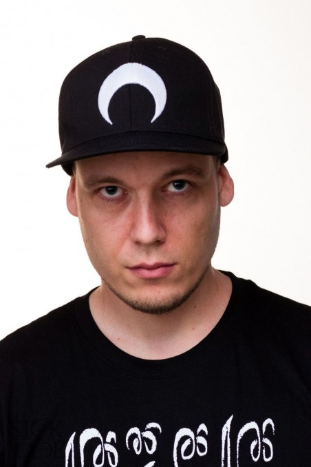 Black snapback with inverted moon embroidery.