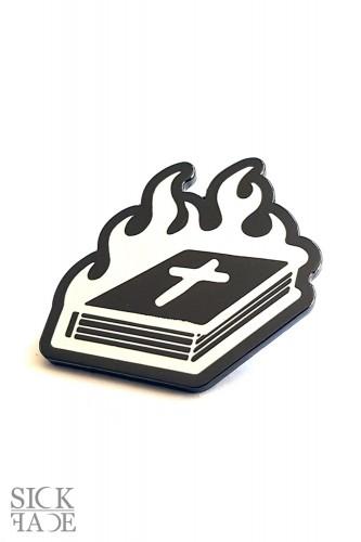 Burning bible enamel pin.