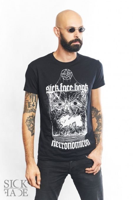 Model in a black unisex SickFace T-shirt with the Necronomicon book design.