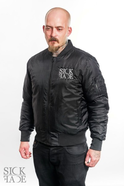 Model in black Zombie Sickface bomber jacket.