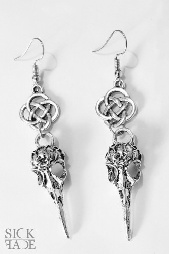Hanging silver earrings with Celtic knot and bird skull.